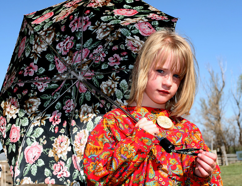 A lovely volunteer and her umbrella. It was a warm day, and I'm sure the umbrella helped keep this gal cool.