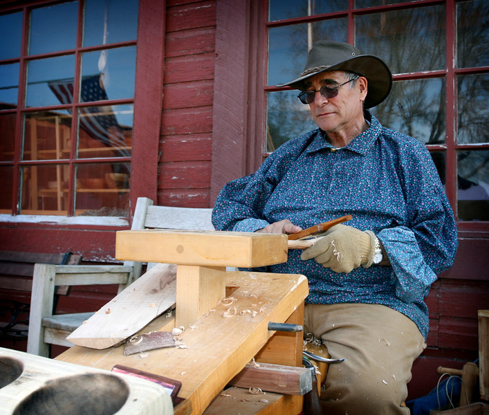 Gary enjoy sitting outside Patch's Woodwright Shop as he works his wood.