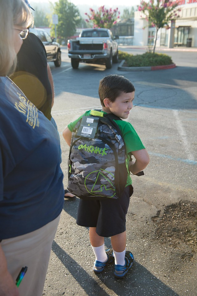 What a smart looking young man. He's going to be proud to wear his new clothes and backpack.