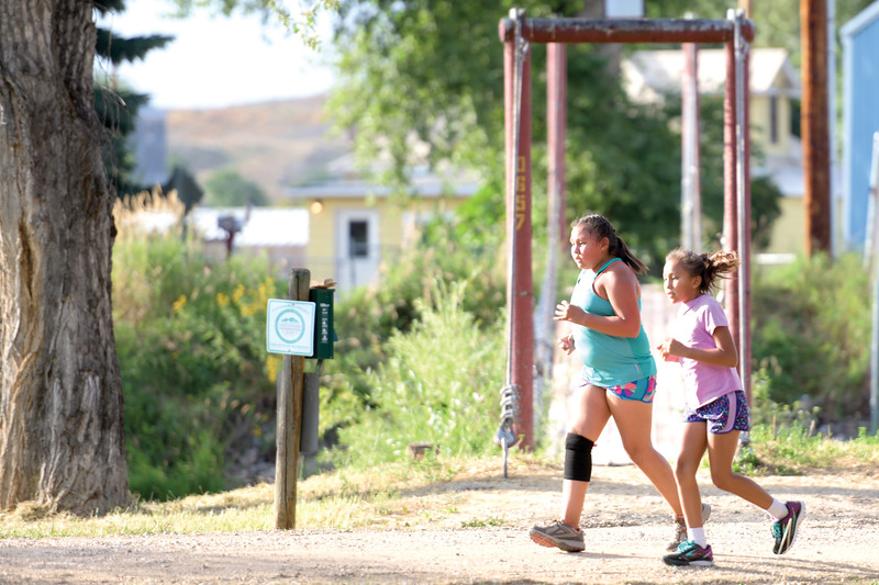 Matthew Gaston | The Sheridan Press<br>Samiya Brown, left, and Kalillah Clair finish their second lap around the Connor Battlefield Historic Site during the Back-to-School 5K in Ranchester Thursday, Aug. 8, 2019.