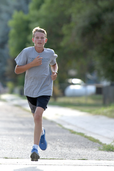 Matthew Gaston | The Sheridan Press<br>Michael Barron maintained an impressive pace during the Back-to-School 5K, finishing second over all Thursday, Aug. 8, 2019.