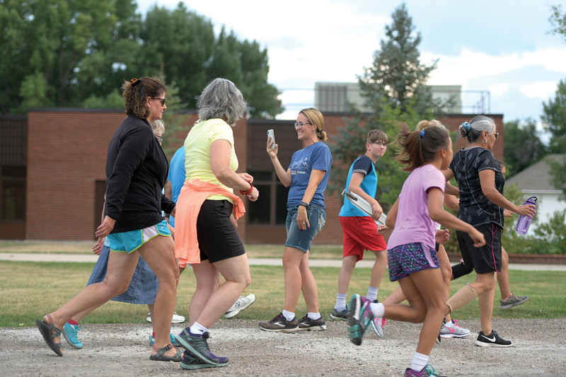 Matthew Gaston | The Sheridan Press<br>Lacee Schwend, center, shoots a video of the runners leaving the starting line at the Tongue River Valley Community Center for the Back-to-School 5K in Ranchester Thursday, Aug. 8, 2019.