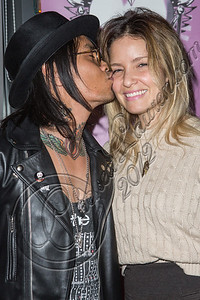 "LOS ANGELES, CA - DECEMBER 12:  Guitarist Stevie D. of Buckcherry (L) and wife Jaime Dacanay attend The Backstage Artist Lounge's 12-12-12 industry event supporting the ""I Have A Dream"" foundation at The Gibson Showroom on December 12, 2012 in Los Angeles, California.  (Photo by Chelsea Lauren/WireImage)"