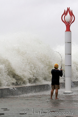 Images taken in Manila a few hours after the typhoon Frank (fengshen) hit the capital of Philippines A fisherman is defying the rough sea.