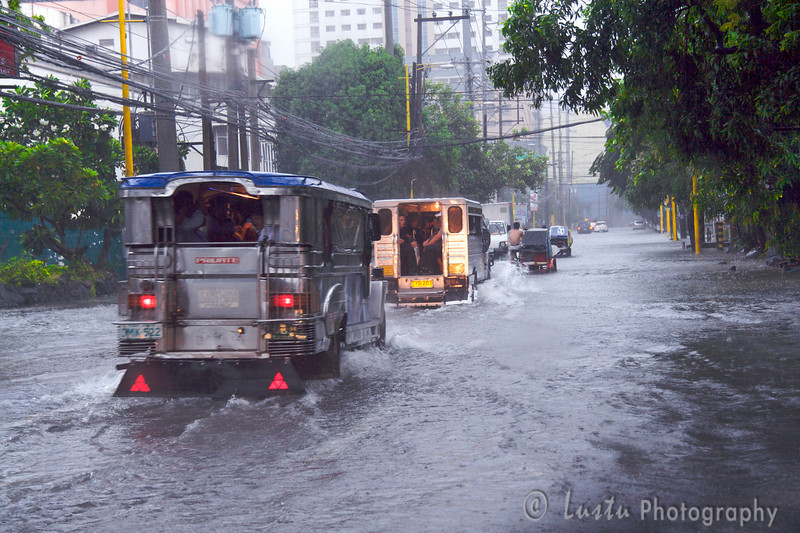 Images taken in Manila a few hours after the typhoon Frank (fengshen) hit the capital of Philippines. Jeepneys driving in the middle of a flooded boulevard