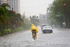 Images taken in Manila a few hours after the typhoon Frank (fengshen) hit the capital of Philippines. A bicyclist is riding in the middle of a flooded boulevard.