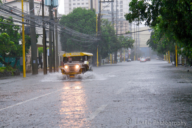 Images taken in Manila a few hours after the typhoon Frank (fengshen) hit the capital of Philippines. A jeepney driving in the middle of a flooded boulevard