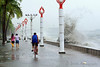 Images taken in Manila a few hours after the typhoon Frank (fengshen) hit the capital of Philippines. Pedestrians walking and a bicyclist riding along Manila Bay defying rough sea.