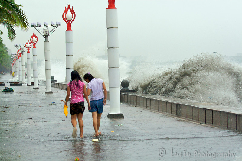 Images taken in Manila a few hours after the typhoon Frank (fengshen) hit the capital of Philippines. Pedestrians are walking along the bay defying the rough sea and big waves.