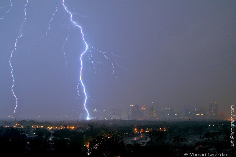 Furious thunderstorm over Manila, Philippines, with lightening hitting the ground.