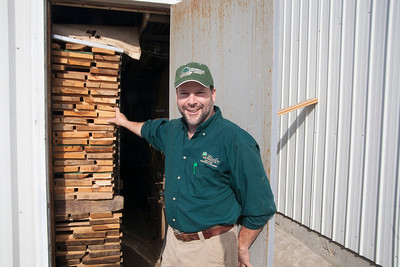 Patriot photo by Roxanne Richardson Jeffrey Schucker in front of one of his kilns.