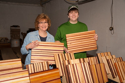 Patriot photo by Roxanne Richardson Leslie Schucker and her son, David, showed off their cutting boards. These cutting boards were made from maple and walnut as well as more exotic woods such as yellow heart and blood wood.
