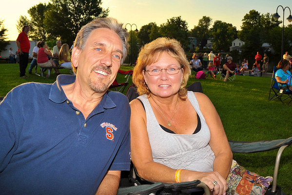 Carl Lutz ('75) and his wife, Debby Lutz, enjoying the music during the 2011 Baldwinsville Alumni weekend presented by the C. W. Baker Alumni Association at Paper Mill Island in Baldwinsville, New York on Friday, August 5, 2011.