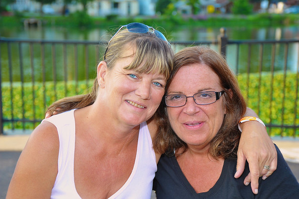 Tammy Savanovitch ('78) and Pam Minnoe ('77) relaxing on a bench during the 2011 Baldwinsville Alumni weekend presented by the C. W. Baker Alumni Association at Paper Mill Island in Baldwinsville, New York on Friday, August 5, 2011.
