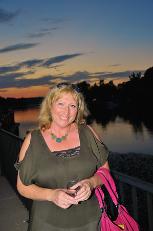 Carla Heyn Ramirez ('77) posting with the sunset at the 2011 Baldwinsville Alumni weekend presented by the C. W. Baker Alumni Association at Paper Mill Island in Baldwinsville, New York on Friday, August 5, 2011.