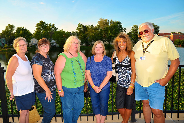 Sandy Thomas ('75), Linda Truglio ('75), Bonnie Forderkonz Morgenstern ('75), Laurie Comins O'Neil ('76), Laurei Beaver Hogan ('75) and Doug West ('72) posing by the river during the 2011 Baldwinsville Alumni weekend presented by the C. W. Baker Alumni Association at Paper Mill Island in Baldwinsville, New York on Friday, August 5, 2011.