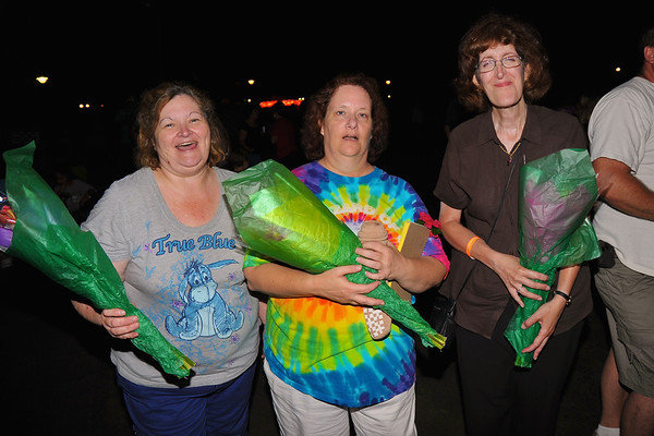 Lynnette Yager Barbano ('77), Annette Emerson Morris ('77) and Eileen Blair with flowers at the 2011 Baldwinsville Alumni weekend presented by the C. W. Baker Alumni Association at Paper Mill Island in Baldwinsville, New York on Friday, August 5, 2011.