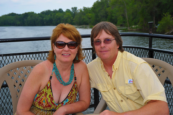 Lori Robbins ('76) and John Reidy ('76) enjoying the Mid-Lakes Navigation Lunch Cruise on the Seneca River during the 2011 Baldwinsville Alumni weekend presented by the  C. W. Baker Alumni Association on Saturday, August 6, 2011.