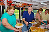 Diana Johnson Austin ('75) and George Sterling filling their plates during the Mid-Lakes Navigation Lunch Cruise on the Seneca River during the 2011 Baldwinsville Alumni weekend presented by the  C. W. Baker Alumni Association on Saturday, August 6, 2011.