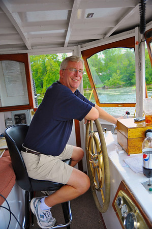 Captain of the Emita II piloting during the Mid-Lakes Navigation Lunch Cruise on the Seneca River during the 2011 Baldwinsville Alumni weekend presented by the C. W. Baker Alumni Association on Saturday, August 6, 2011.
