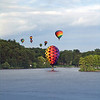 2007 Media night the week before Balloonfest. A beautiful night as these balloons took off from Howell City Park and then floated over Thompson Lake... and two swans– what luck!