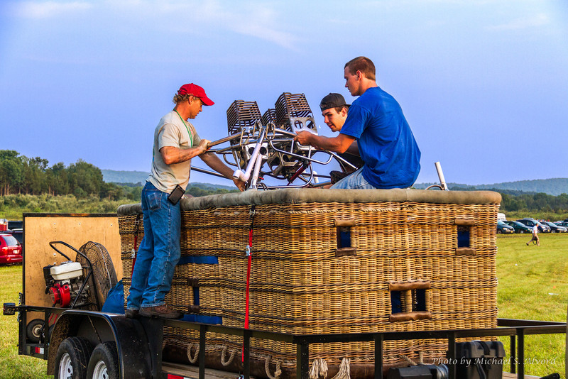 Our Pilot in the red hat and his crew assembling the burners.