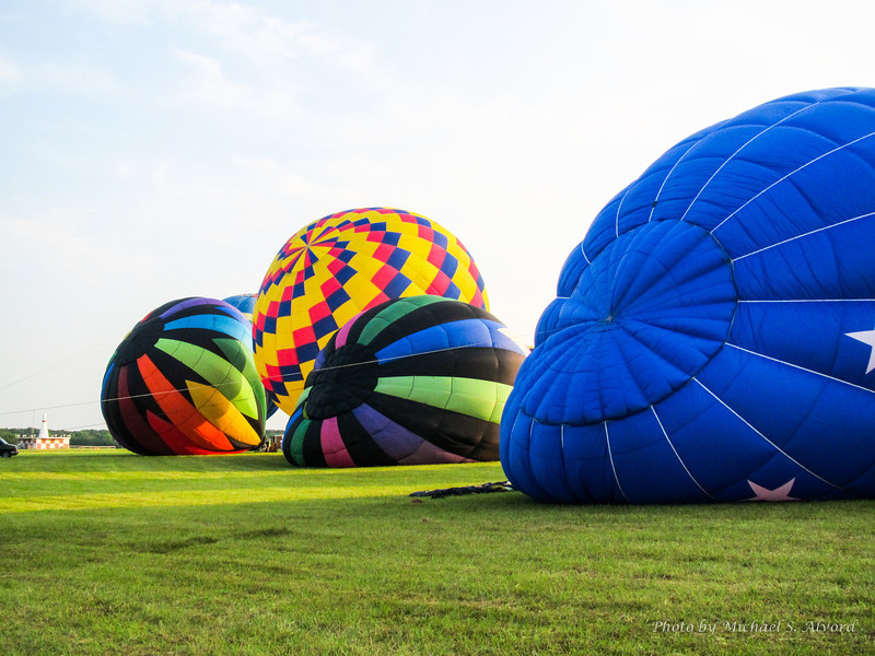 Partially inflated balloons.