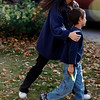 Six-year-old Falcon Heene, front, is guided back to a news conference by his mother, Mayumi, outside the family's home in Fort Collins, Colo., after Falcon Heene was found hiding in a box in a space above the garage on Thursday, Oct. 15, 2009. Falcon Heene at first had been reported to be aboard a flying-saucer-shaped balloon fashioned by his father and then carried by high winds on to the plains of eastern Colorado. (AP Photo/David Zalubowski)