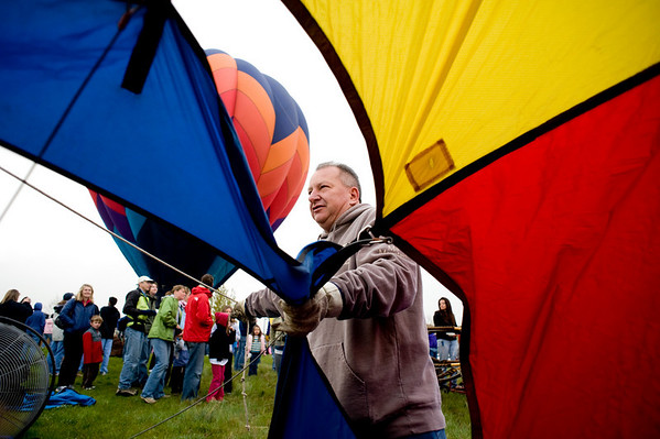 Gary Hegner, of Erie, secures the balloon at the Erie Town Fair Balloon Festival at Vista Ridge golf course in Erie, Saturday, May 15, 2010. Though the balloon launch for the morning was cancelled, several balloons were blown up for the public to see and ask the pilots questions. <br /> <br /> <br /> <br /> Kasia Broussalian