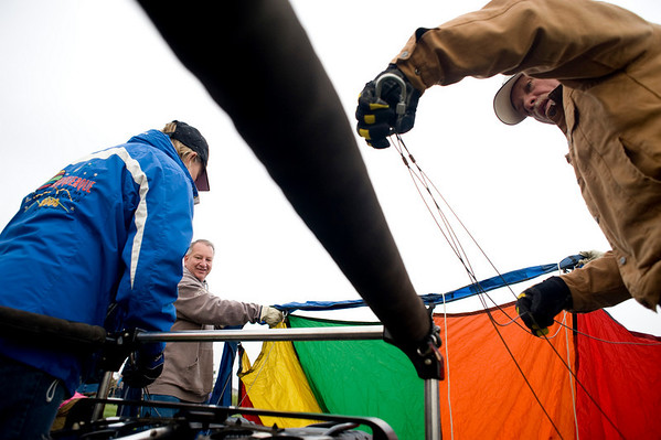 Colleen Johnson and her husband Mike Johnson (right) of Albuquerque, attach the balloon to the basket at the Erie Town Fair Balloon Festival at Vista Ridge golf course in Erie, Saturday, May 15, 2010. Though the balloon launch for the morning was cancelled, several balloons were blown up for the public to see and ask the pilots questions. <br /> <br /> <br /> <br /> Kasia Broussalian