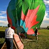 The balloon is coming down after a perfect, soft landing in the field