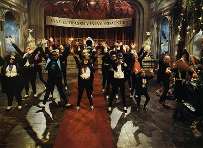 A scene from The Rocky Horror Picture Show.  The film is considered a cult classic and is still in limited release 35 years after its premiere.  It gained notoriety as a midnight movie in 1977 when audiences began participating with the film in theatres across the United States.  When Lisa and I were in high school, it was just getting popular for kids to go the the weekly midnight showing to chant the Rocky Horror songs and throw popcorn at the screen.