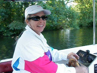"""We rented one of Oakley Courts electric boats for a run up and down the Thames.  This is a video clip of Lisa steering the boat down a narrow Thames River tributary that reminded us of Disneyland's """"Jungle Cruise"""" ride."""