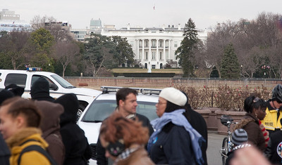 The south portico of the White House. Note the crowds on the roof of the building at left and the TV lights of the four rooftop booths (near left of the WH) --President Barack Obama's Second Inauguration, Jan 21, 2013