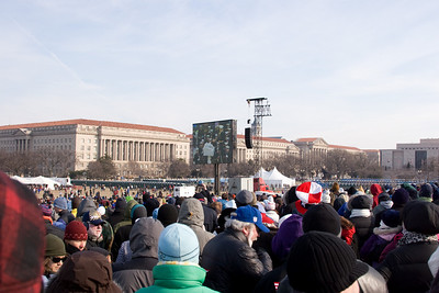 From the grounds of the Washington Monument, looking northeast towards the Jumbotron screen.  The Herbert Hoover Building (Commerce Department) is in the background (with the National Musuem of American History at far right). -- Presidential Inauguration for Barack Obama, Jan 20, 2009. It was about 25 degrees out with a crowd estimated at 1.5-1.8 million people.