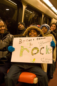 On Metro's Red Line heading downtown. One stop later this train was far too full for me to kneel for a photo as I did here. -- Presidential Inauguration for Barack Obama, Jan 20, 2009. It was about 25 degrees out with a crowd estimated at 1.5-1.8 million people.