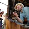 """Allegra Grendele, 9, listens to Aaron Richmond explain horseshoeing.<br /> Boulder County  hosted  Barnyard Critter Day  on June 24 at the Agricultural Heritage Center in Longmont, at 8348 Highway 66.<br /> For more photos and a video of the event, go to  <a href=""""http://www.dailycamera.com"""">http://www.dailycamera.com</a>.<br /> Cliff Grassmick / June 24, 2012"""
