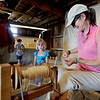 """Angella Dirks, right, shows Anni Haakenson, 5, and her dad, Dean how to spin yard.<br /> Boulder County  hosted  Barnyard Critter Day  on June 24 at the Agricultural Heritage Center in Longmont, at 8348 Highway 66.<br /> For more photos and a video of the event, go to  <a href=""""http://www.dailycamera.com"""">http://www.dailycamera.com</a>.<br /> Cliff Grassmick / June 24, 2012"""