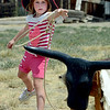 """Izzy Faye, 5, tries her hand at roping steers durin Barnyard Critter Day.<br /> Boulder County  hosted  Barnyard Critter Day  on June 24 at the Agricultural Heritage Center in Longmont, at 8348 Highway 66.<br /> For more photos and a video of the event, go to  <a href=""""http://www.dailycamera.com"""">http://www.dailycamera.com</a>.<br /> Cliff Grassmick / June 24, 2012"""