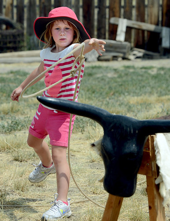 "Izzy Faye, 5, tries her hand at roping steers durin Barnyard Critter Day.<br /> Boulder County  hosted  Barnyard Critter Day  on June 24 at the Agricultural Heritage Center in Longmont, at 8348 Highway 66.<br /> For more photos and a video of the event, go to  <a href=""http://www.dailycamera.com"">http://www.dailycamera.com</a>.<br /> Cliff Grassmick / June 24, 2012"
