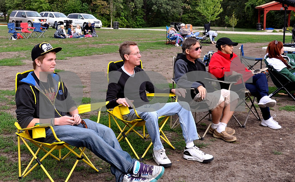 Doug Glaman, his father Scott Glaman, and Roger and Angie Messerly came out to enjoy the bands at the bandshell Saturday night. Scott Glaman said rain had been sprinkling for a few minutes, but it didn't last long.