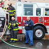 Debbie Blank | The Herald-Tribune<br /> Some Batesville firefighters stayed near vehicles to assist others at the scene.