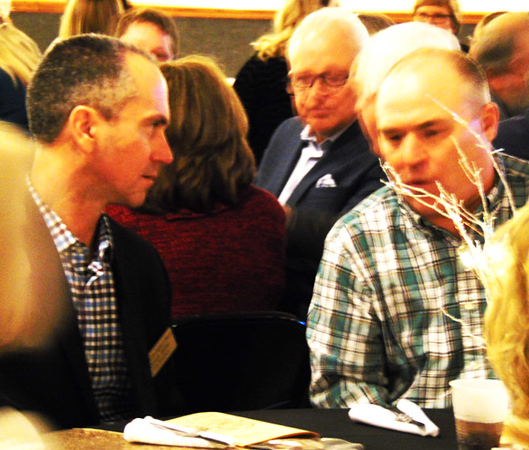 Chamber Vice President Dustin Tarter (left) chats with Dan Kirchgassner before dinner.