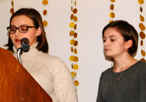 """Biz Mullen (left) and Ciera Belter introduced Volunteer of the Year recipient Kim Linkel. Mullen announced, """"It is easy to see that Kim has a true passion for giving back to her community."""""""
