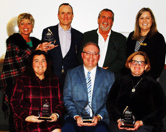 Batesville Area Chamber of Commerce President Mary Huntington (back row far left) and executive director Tricia Miller (far right) congratulate annual dinner honorees: Organization/Community Impact Award winner the John A. Hillenbrand Foundation, represented by Bill Hillenbrand and Peter Hillenbrand (Claire Sherman is not pictured); (front row from left) Volunteer Award winner Kim Linkel, Educator of the Year Paul Ketcham and Distinguished Service Award winner Mary Dickey.