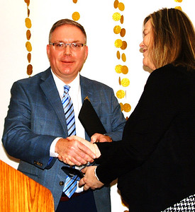 """Paul Ketcham gets his trophy from Batesville Area Chamber of Commerce executive director Tricia Miller. He said, """"I am truly humbled to be on this stage tonight."""""""