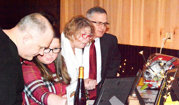 Will Fehlinger   The Herald-Tribune<br /> Attendees had opportunties to bid on a variety of silent auction items.