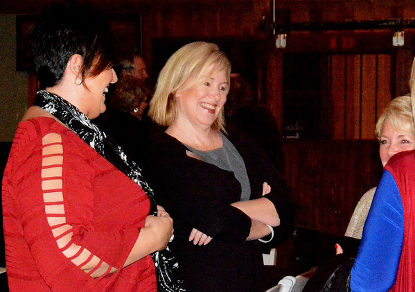 Debbie Blank | The Herald-Tribune<br /> Incoming chamber Vice President Maggie Henson (from left) of Batesville Tool & Die, outgoing President Carrie Rupp of MainSource Bank and incoming President Bev Broughton of Steak N' Shake share a laugh before dinner.