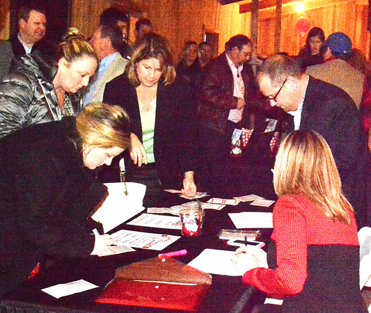 Debbie Blank   The Herald-Tribune<br /> The check-in area at The Barn at Walhill Farm was swamped around 5:35 p.m. Thursday, Jan. 26, 2017, as Batesville Area Chamber of Commerce annual dinner guests arrived.