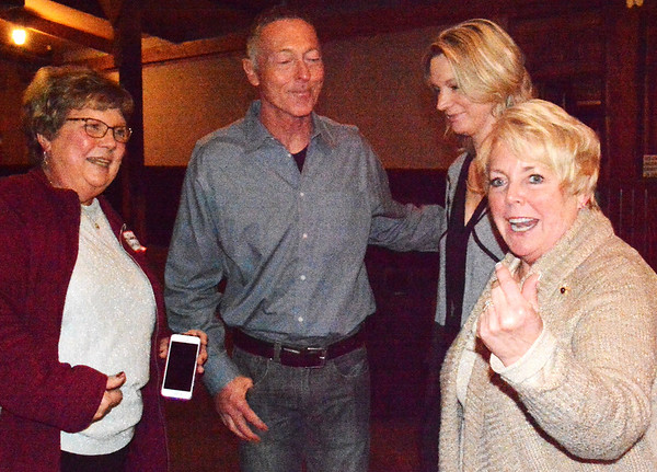 Debbie Blank | The Herald-Tribune<br /> Former Cincinnati Red Dave Collins greets well-wishers after his speech, including incoming Batesville Area Chamber of Commerce President Bev Broughton (right).